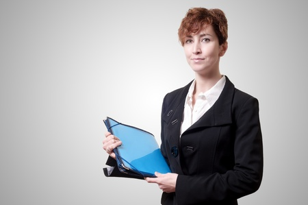 success business woman with briefcase on gray background Stock Photo - 18490511
