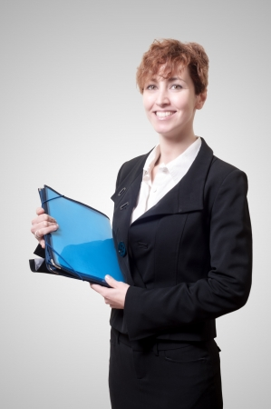 success business woman with briefcase on gray background Stock Photo - 18490563