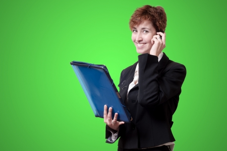 success business woman with briefcase and phone on green background Stock Photo - 18490513