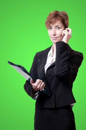 success business woman with briefcase and phone on green background Stock Photo - 18490648