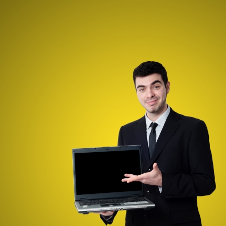 business man with notebook on yellow background photo