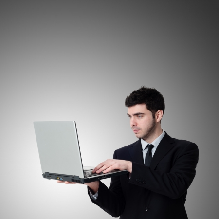 business man with notebook on gray background photo