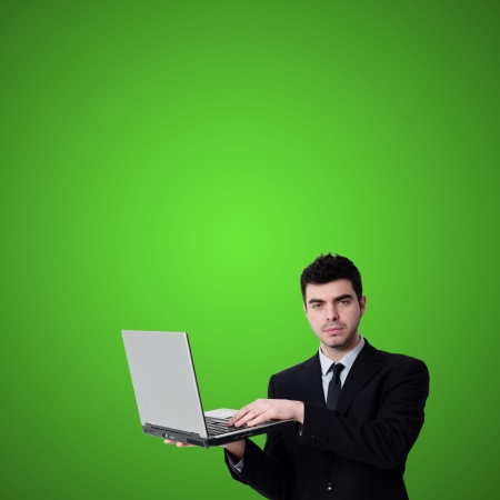 business man with notebook on green background photo