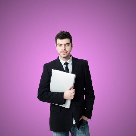 business man with notebook on pink background photo
