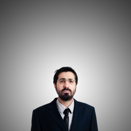 sad businessman on gray background photo