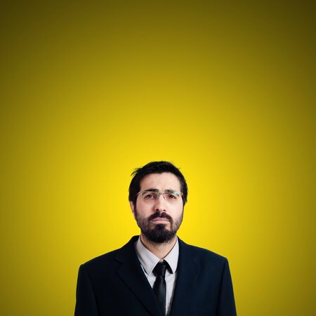 sad businessman on yellow background photo