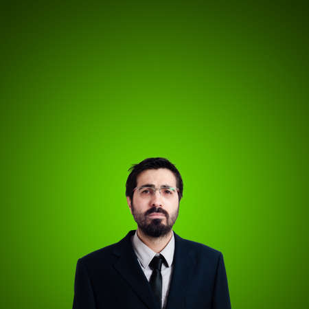 sad businessman on green background photo