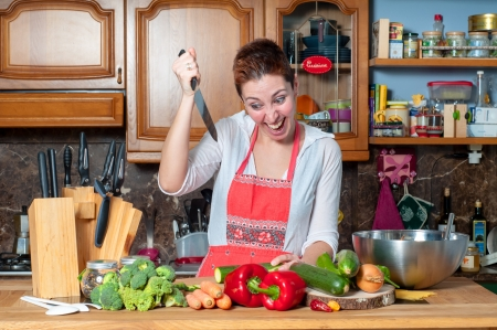 beautiful housewife cooking vegetables in the kitchen Stock Photo - 18661625