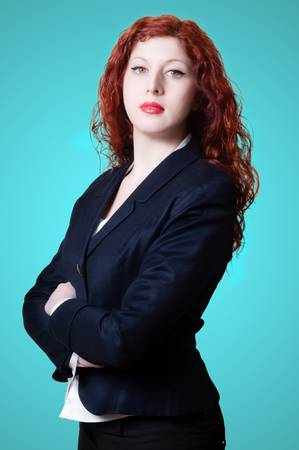 long red hair woman: success business long red hair woman on blue background Stock Photo