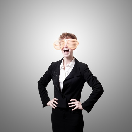 tailleur: businesswoman with big funny eyeglasses screaming on gray background Stock Photo