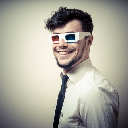 stereoscopic: businessman with 3d eyewear on gray background