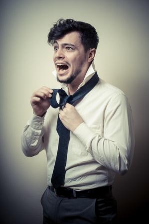 Sexy stylish businessman adjusting tie on gray background Stock Photo - 18823221