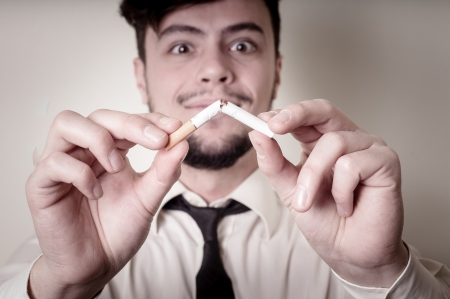 businessman stop smoking on gray background photo