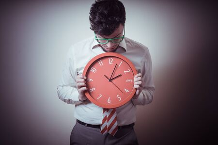 funny businessman with wall clock on gray background photo