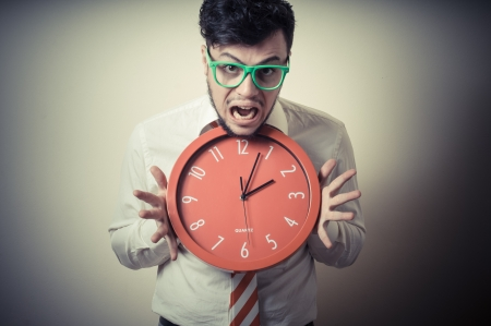 funny businessman with wall clock on gray background Stock Photo - 18970778