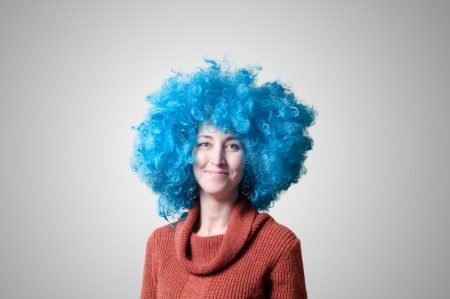 beautiful girl with curly blue wig and turtleneck on colorful background photo