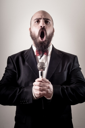 funny bearded man:  funny elegant singer bearded on vignetting background