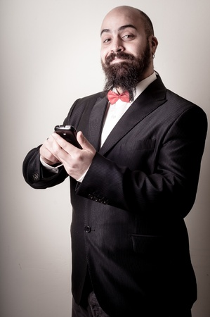 bald ugly:  funny elegant bearded man on the phone on vignetting background