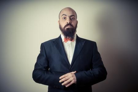 funny elegant bearded man on vignetting background photo