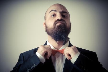 bald ugly:  funny elegant bearded man on vignetting background
