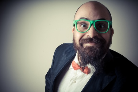 bald ugly:  funny elegant bearded man on vignetting background