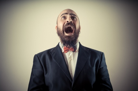 bald ugly: funny afraid elegant bearded man on vignetting background