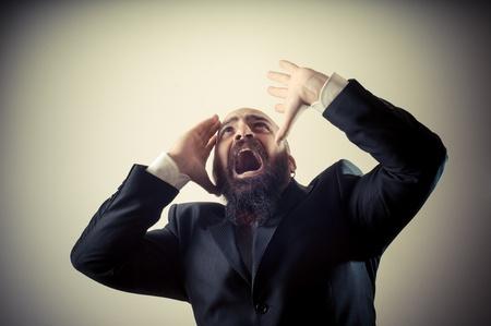 bald ugly: funny afraid elegant bearded man on vignetting background