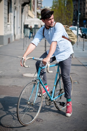 hipster young man on bike in the city