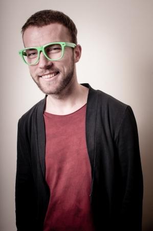 stylish hipster man portrait on gray background photo