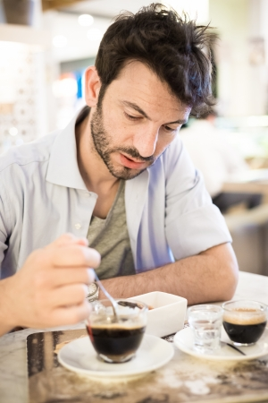 man at the bar drinking coffee in the morning
