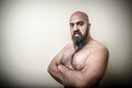 hairy chest: super power angry muscle bearded man  on gray background
