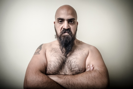 human chest: super power angry muscle bearded man  on gray background