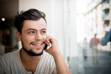 young stylish man at the bar on the phone