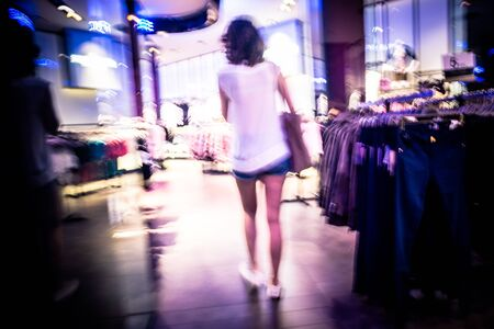 abstract woman shopping in shop photo