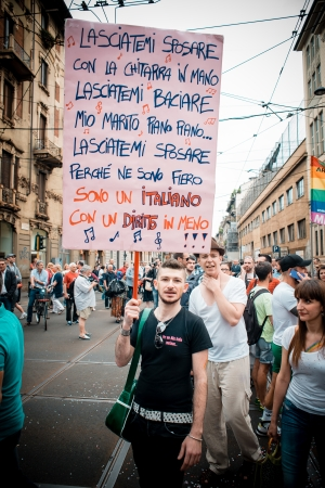 bisexuals: MILAN, ITALY - JUNE 29: gay pride manifestation in Milan June 29, 2013. Normal people, gay, lesbians, transgenders and bisexuals take to the street for their rights organizing a street parade party