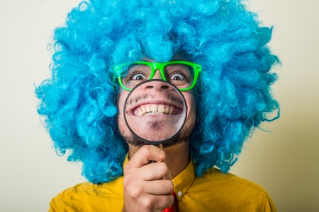 crazy funny young man with blue wig on white background Reklamní fotografie