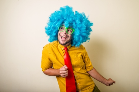 crazy funny young man with blue wig on white background Zdjęcie Seryjne