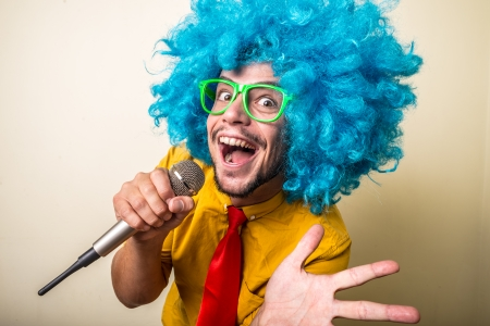 crazy funny young man with blue wig on white background Stockfoto