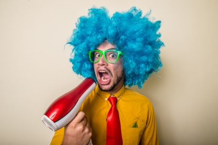crazy funny young man with blue wig on white background Stock Photo - 22315623