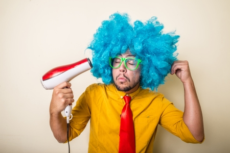 crazy funny young man with blue wig on white background Stock Photo - 22315625