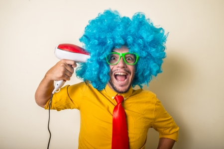 crazy funny young man with blue wig on white background Stock Photo - 22315629