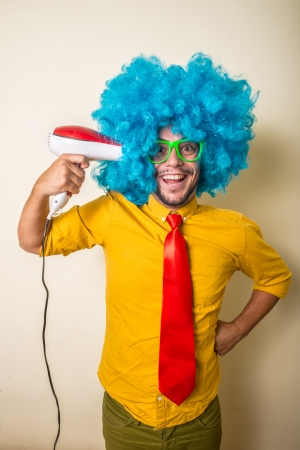 crazy funny young man with blue wig on white background Stock Photo - 22315630
