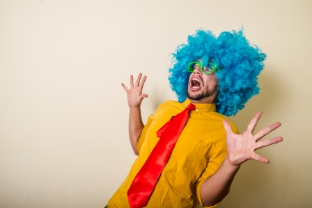 crazy funny young man with blue wig on white background Stock Photo - 22315631