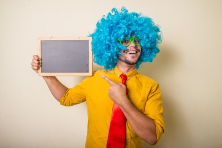 crazy funny young man with blue wig on white background Фото со стока