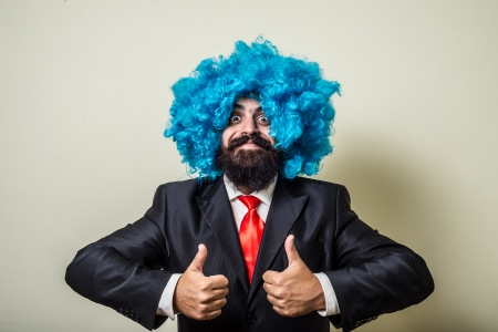 funny bearded man: crazy funny bearded man with blue wig on white background Stock Photo