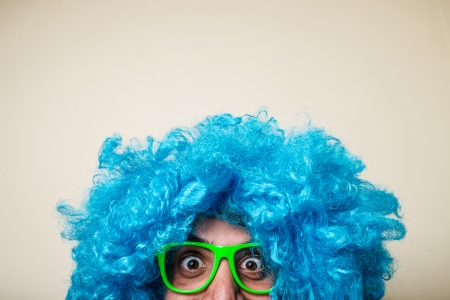 crazy funny bearded man with blue wig on white background Stock Photo - 22315672