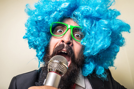 crazy funny bearded man with blue wig on white background photo
