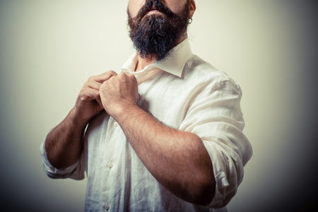 long beard and mustache man with white shirt isolated on gray photo