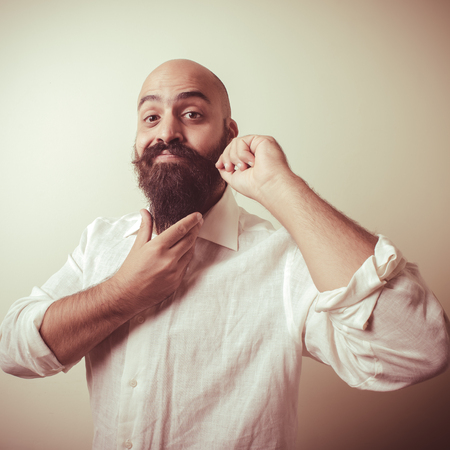 long beard and mustache man with white shirt on gray background Stock Photo - 22501795
