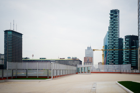 roj: MILAN, ITALY - SEPTEMBER 27: Garibaldi Towers exterior on September 8, 2013. Garibaldi Towers are two important modern skyscrapers, 100 meter high, energy self-sufficient thanks to solar panels and insulating materials